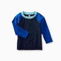 TEA LONG SLEEVE RAGLAN BABY RASH GUARD