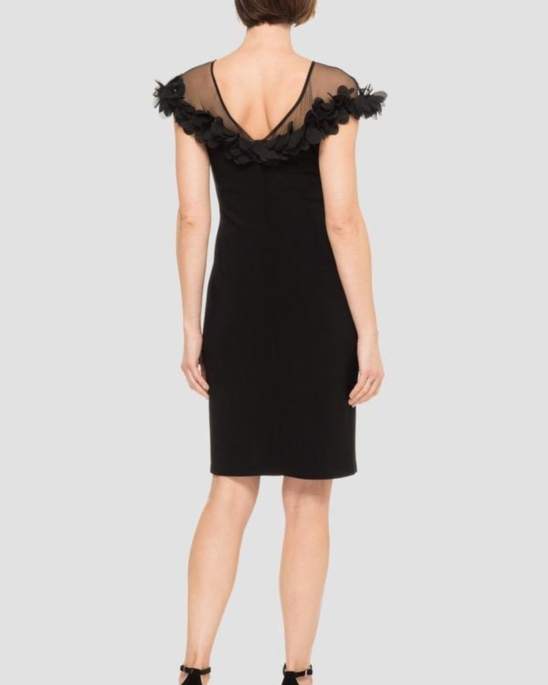 Joseph Ribkoff This elegant cocktail dress has a sheer chest and shoulders with rounded neckline finished off with floral appliques