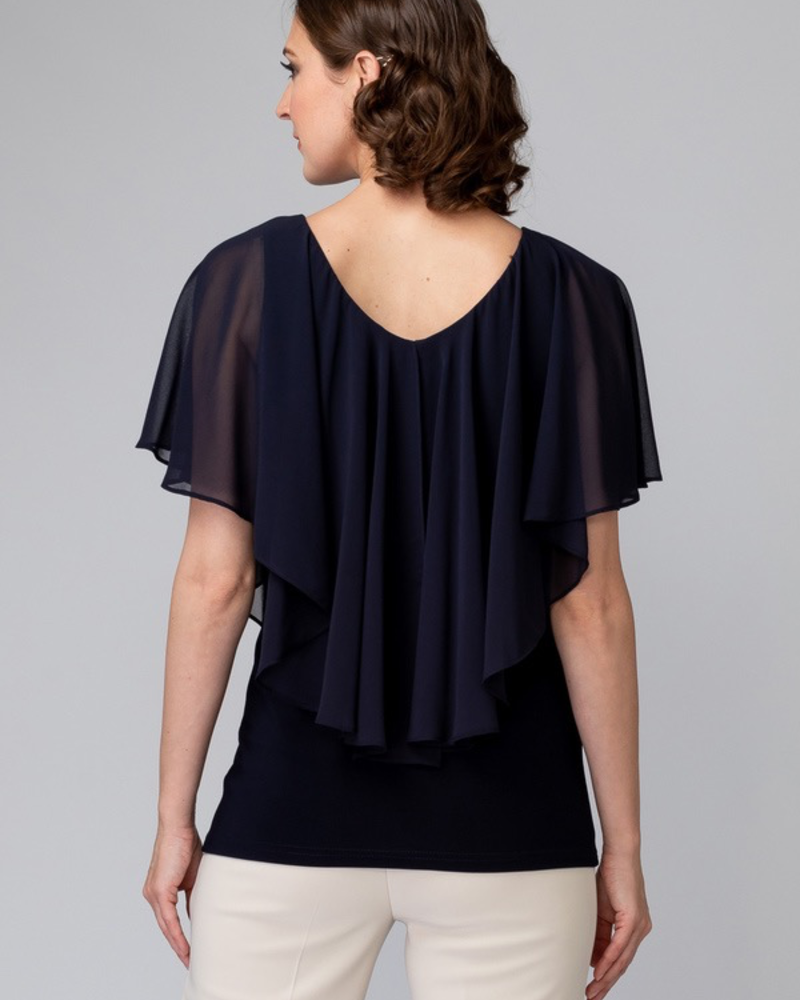 verdigris Sheer, capped sleeves overlay a fitted solid top