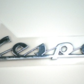 "Parts Emblem, ""Vespa"" Left Side Cowl"