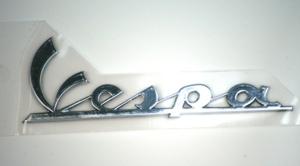 "Parts Emblem, ""Vespa"" Left Side Cowl"