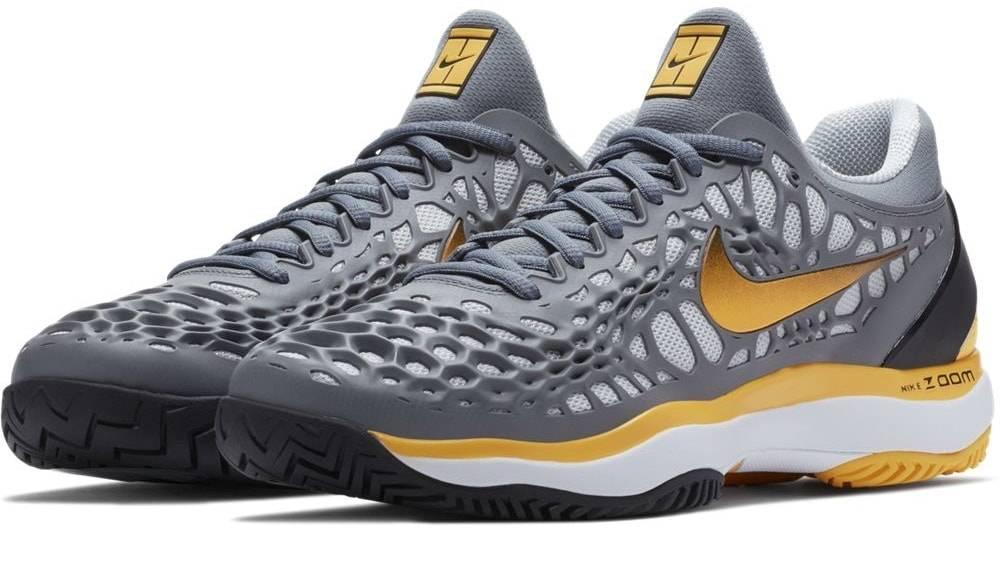 f2ea50631e4d Nike Zoom Cage 3 HC Grey Orange Men s Shoe - Tennis Topia - Best ...