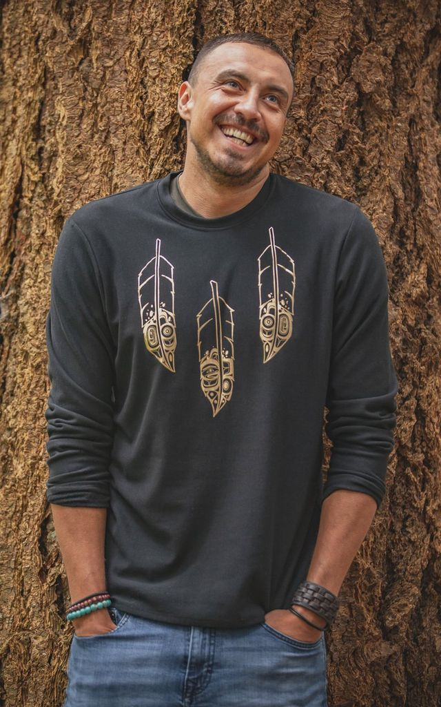 Chloe Angus Designs Our Unisex Sweatshirt is seriously indulgent inside and out. Styled after our classic Unisex Long Sleeve T and featuring Gold or Black Feathers by Heiltsuk artist KC Hall, which ever you choose you will be cozy in our breathable Bamboo Fleece.