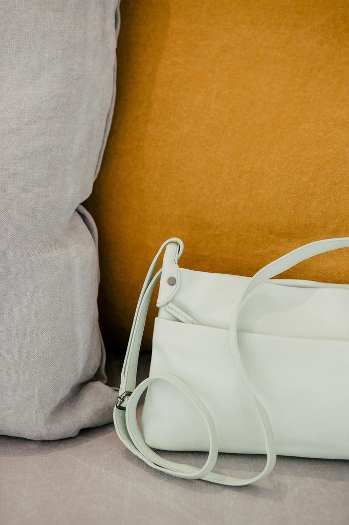 ELK -100% Cow Leather<br /> -Pinched side loop detail with tablet rivets<br /> -Adjustable strap can be worn over the shoulder or across the body<br /> -Zip closure body with separate zip closure front pocket