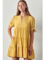 Tiered babydoll dress with v-neck neckline