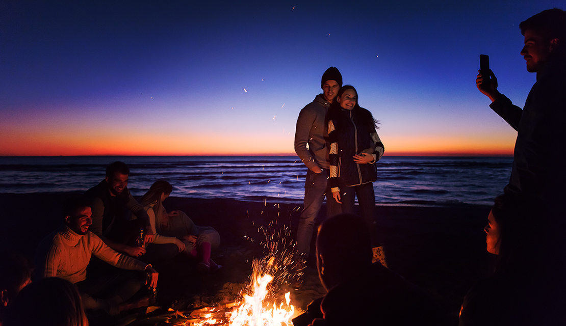bonfire with scuba divers
