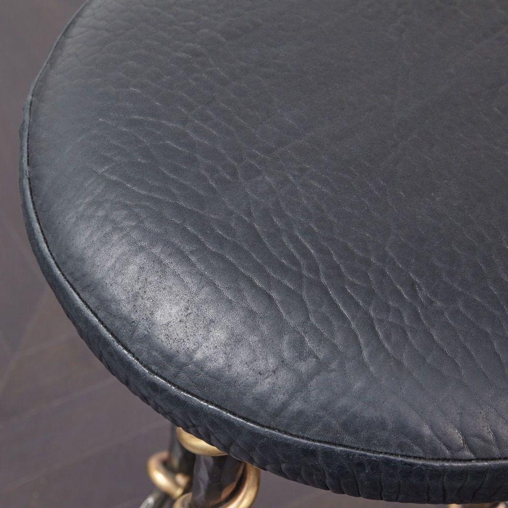 "Kelly Wearstler Kelly Wearstler - Serpent Bar Stool - 15"" Dia x 29"" H <br /> Material: Hand wrought steel frame, bronze detailing, leather upholstery."