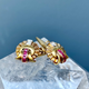 Gold and Ruby Cufflinks - 18ct Yellow Gold Shell Shaped Cufflinks - Old Cut Diamond Bead Set in Platinum on Gold Below a Line of Five Channel Set Square Cut Rubies - 2 Diamonds total 0.08ct, 10 Rubies  Total .40ct - Handmade Mounts c1940