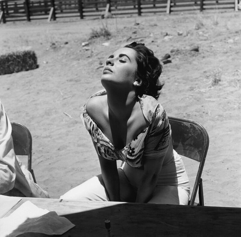 "Elizabeth Taylor sunning herself while on location in Marfa, Texas for the film ""Giant"" 1955 - Sid Avery"