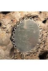 Pendant - argillite, silver backing, Jeannette Gagnon, 1999, raven & eagle