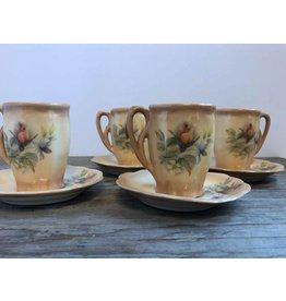 Set of four demitasse cups and saucers
