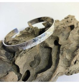 Carved silver First Nations bracelet