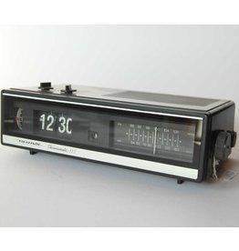 Flip dial alarm clock