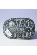 Carved stone beetle