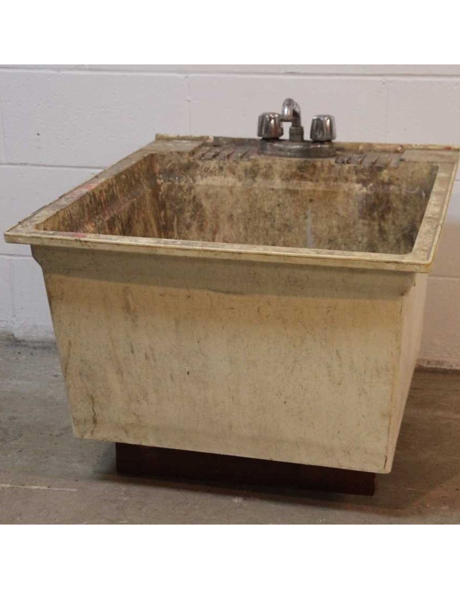 Sink - plastic laundry sink, rough inside but sound