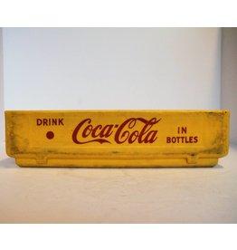 Yellow plastic Coke bottle crate