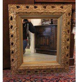Wood framed ornate mirror
