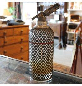 Antique mesh soda bottle