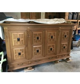 Large, heavily carved sideboard