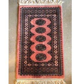 Rose coloured Bokhara carpet