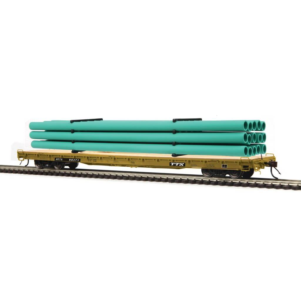 MTH - HO #80-98045, HO TTX (#90371) 60' Wood Deck Flat Car with Green Pipe Load