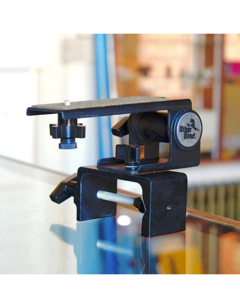 "Other ""The Other Hand"" camera clamp."