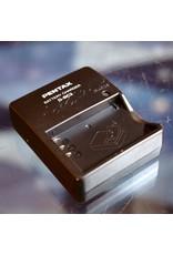Pentax Pentax D-BC2 charger for D-L12 batteries.