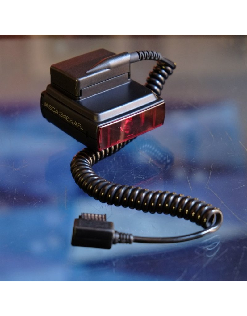 Metz Metz SCA-346/2 AF M4 TTL adapter for Nikon film cameras.