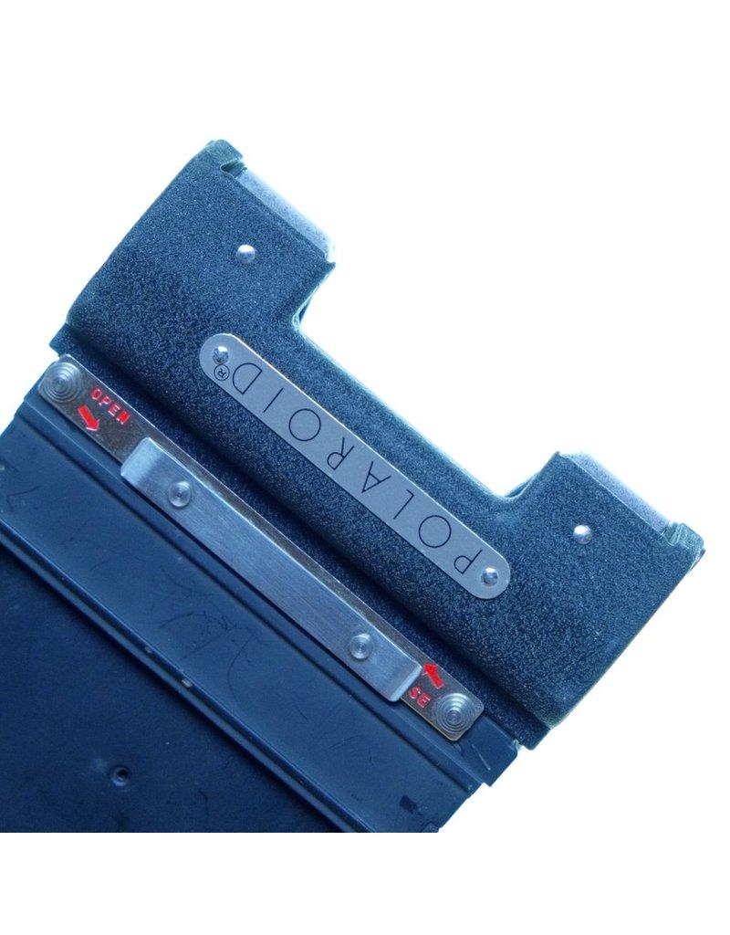 Polaroid Polaroid 500 single-sheet instant film holder.
