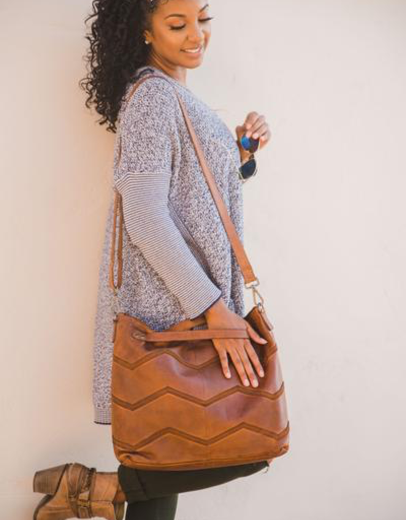 Hope - crossbody tote w/ herringbone pattern on front and zip pocket on back, card and pen slots inside, honey color