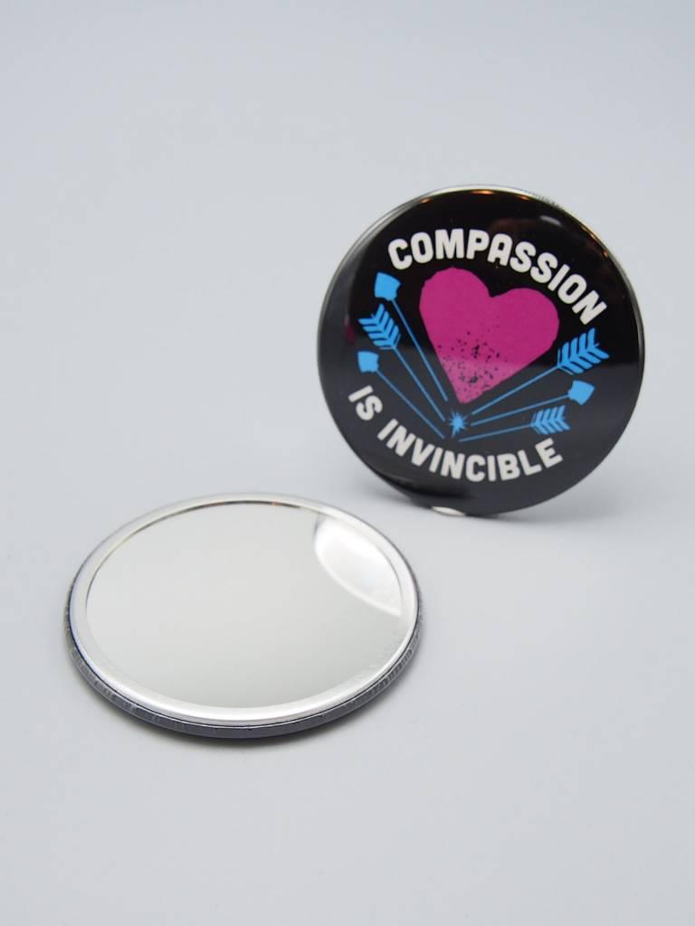 Compassion Is Invincible Arrows Pocket Mirror