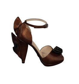 Prada Prada Copper Patent Pumps with Ruffle Detailing