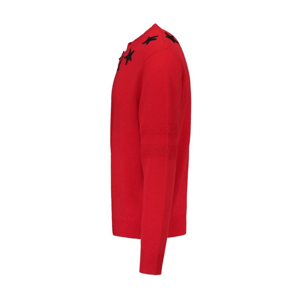 f45e060c250 Givenchy pull rouge avec appliqués d étoiles au collet - Boutique LUC.S