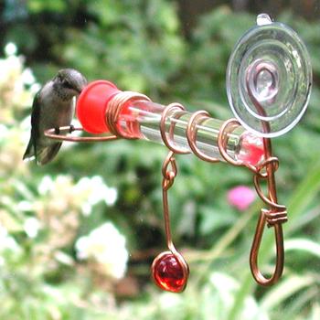 - SONGBIRD ES- SONGBIRD ESSENTIALS 1 TUBE WINDOW WONDER HUMMINGBIRD FEEDERSENTIALS WINDOW WONDER ONE-TUBE FEEDER