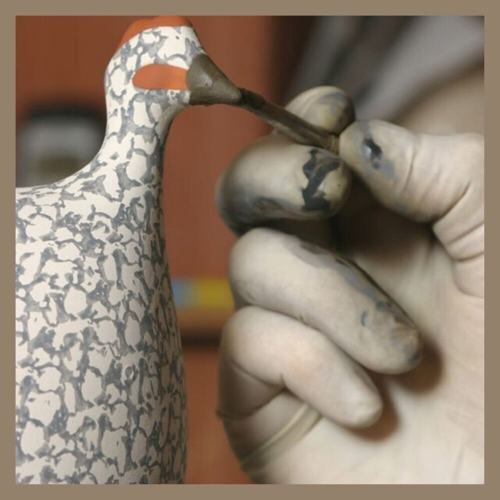 White Speckled Black French Guinea Hen