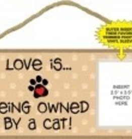 Love is being owned by A CAT Photo Sign
