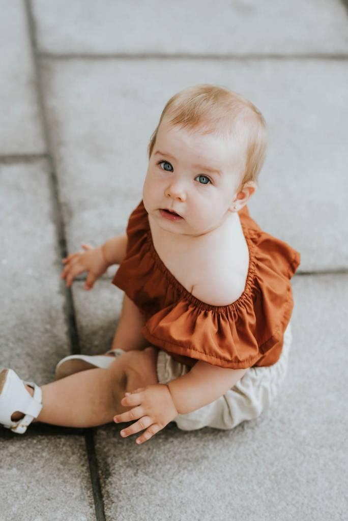 Little Joy by Melissa Lajoie Burnt Orange Ruffle Romper