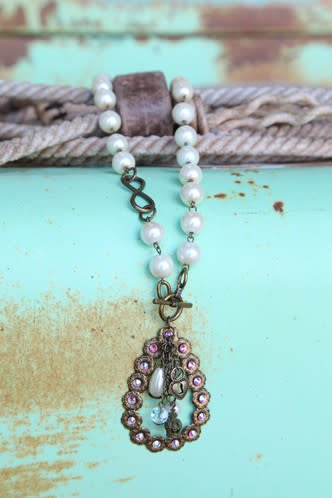 "Pink Panache CRYSTALED OPEN TEARDROP WITH CHARMS ON PEARL BEADS. 19"" (21"" OVERALL)"