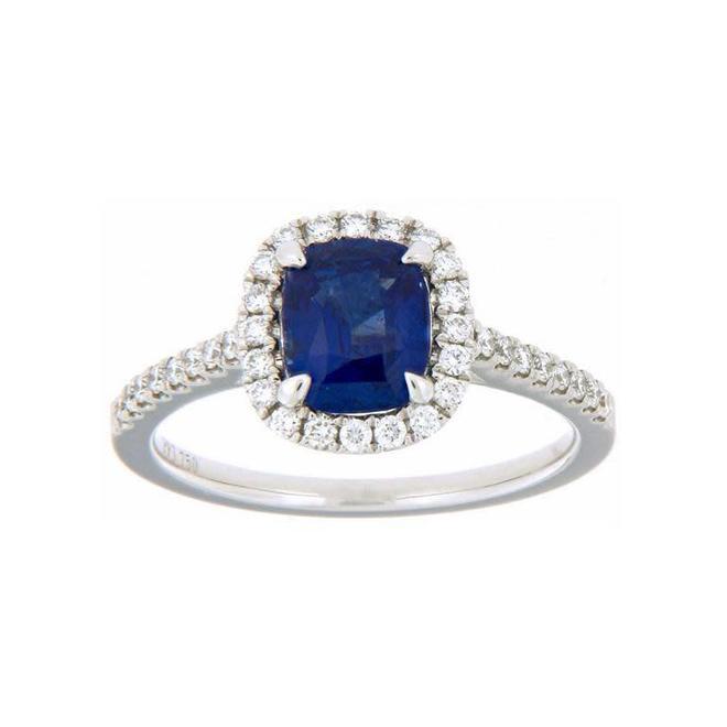 Cushion cut sapphire and diamond halo ring