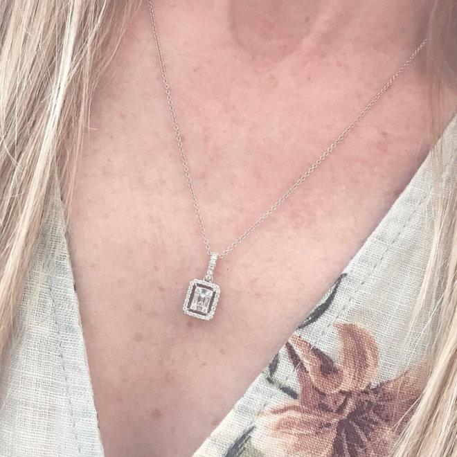 Emerald shape diamond cluster halo pendant