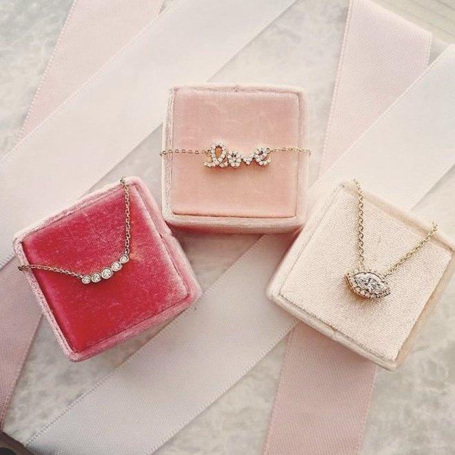 Five diamond bezel set necklace
