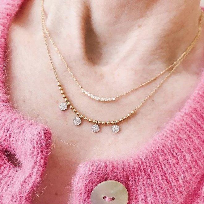Nine diamond bezel set necklace - yellow gold