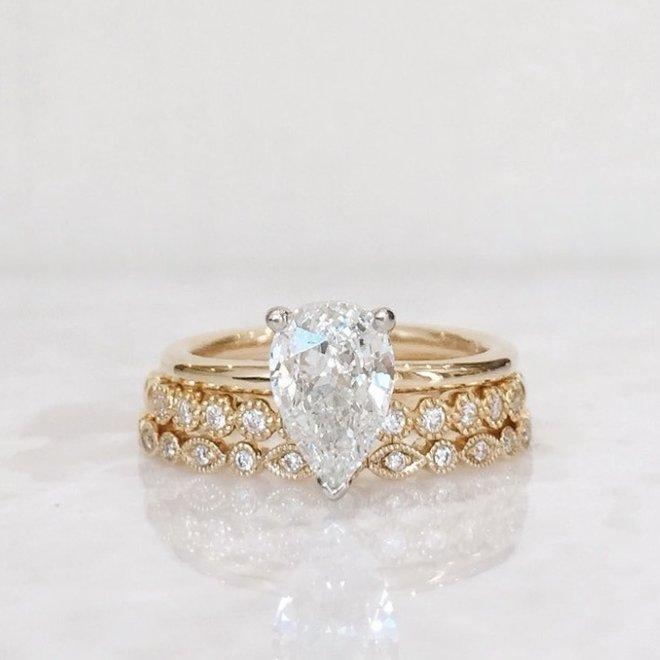Yellow gold pod and bezel set diamond stackable band
