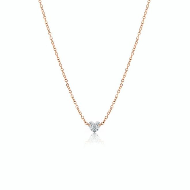 Floating heart shaped diamond pendant