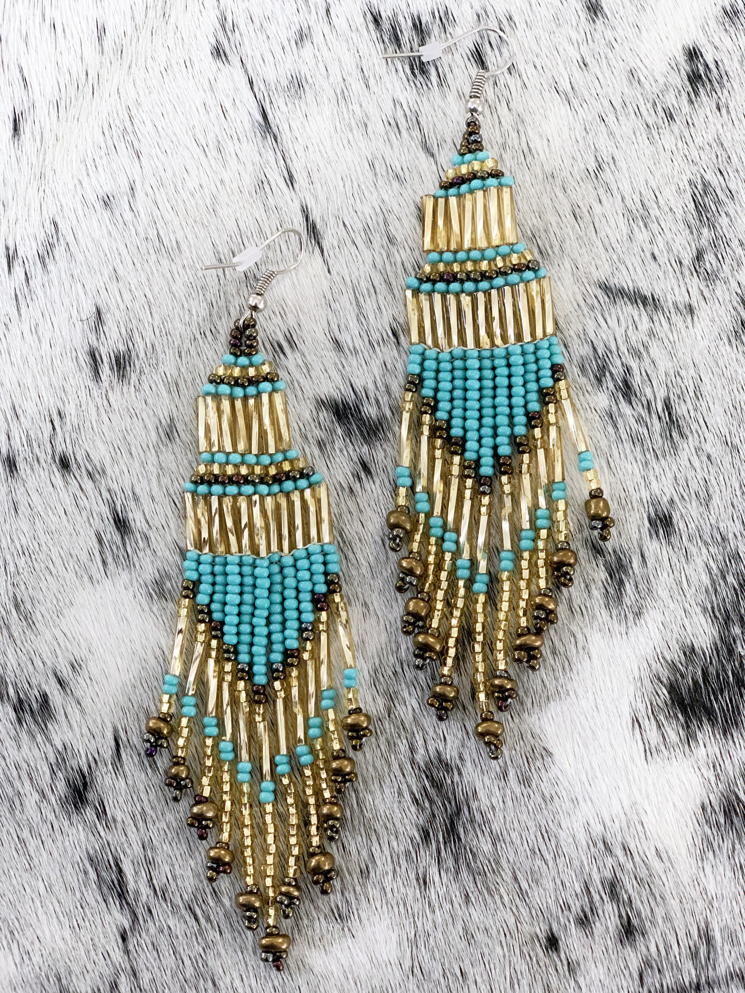 How to add some sparkle to your fashion statement??  Try these Peruvian made earrings.
