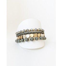 Ens. de 4 bracelets avec billes de bois et métal-gris/or