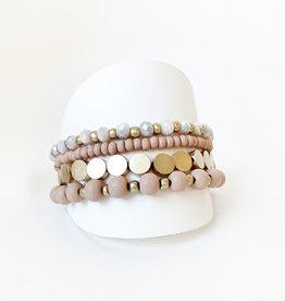 Ens. de 4 bracelets avec billes de bois et métal-rose/or