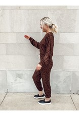 The Let My Heart Run Knit Top