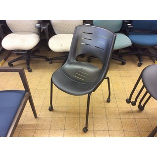 Black plastic stacking chair on castors (10/14/20)