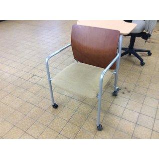 Tan padded metal frame wood back side chair on castors (11/20/19)